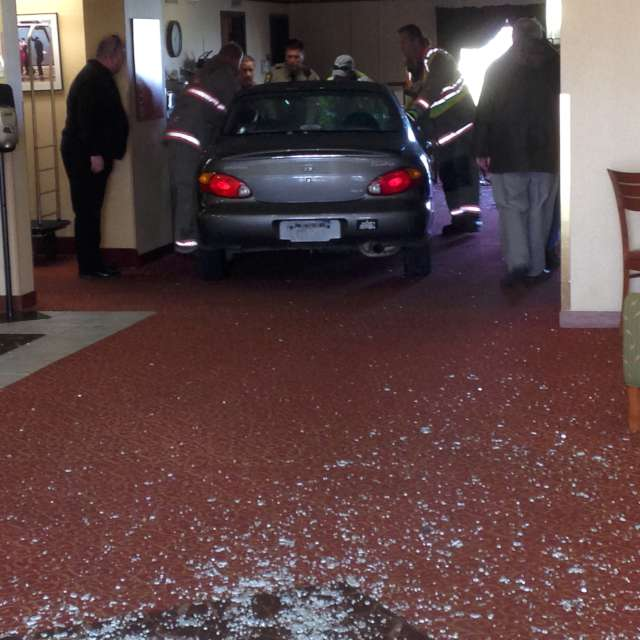 Car Crashes Into Comfort Suites Lobby